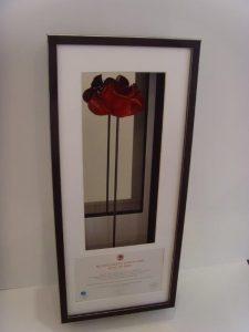 Framed ceramic poppy